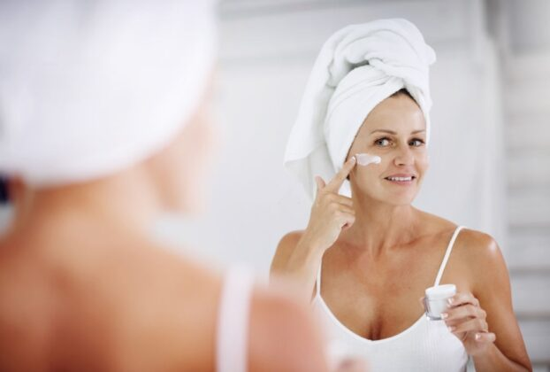 Cropped Shot Of A Mature Woman Applying Moisturizer To Her Face